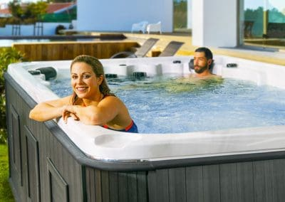 Couple having fun in swim spa
